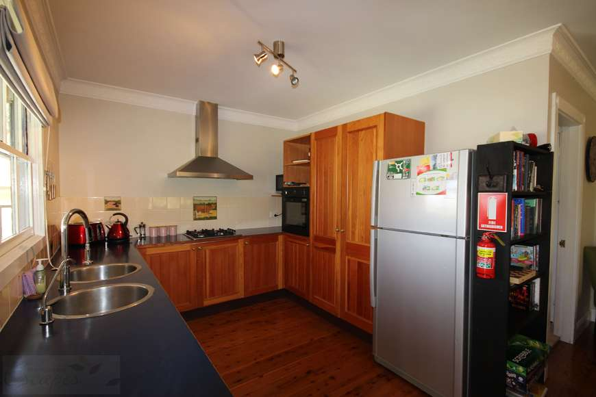 Spacious kitchen with gas cooktop and electric wall oven