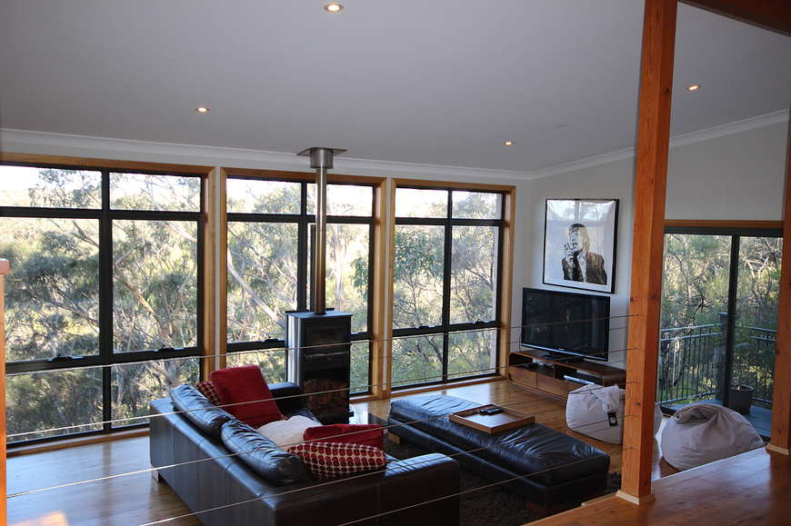 Tastefully decorated lounge with bushland views
