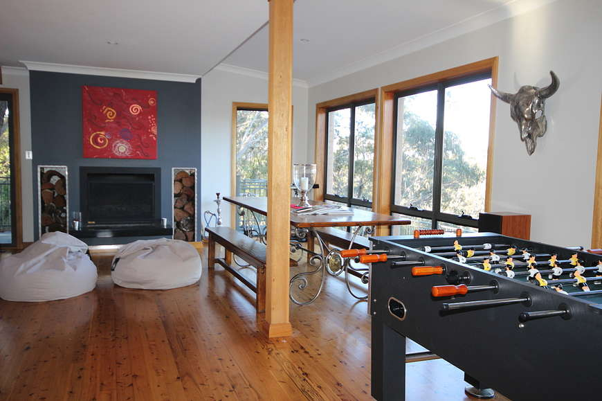 Open fireplace in the dining area with a foosball table