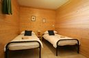 Chalet Quatre Saisons; ground floor twin bedroom