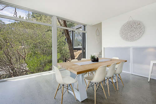 With the electric blinds up - sit back and overlook the native gardens