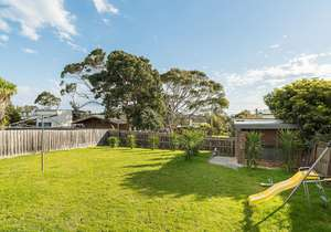 Huge, fully fenced backyard with play equipment...