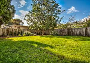 Large, fully fenced backyard...