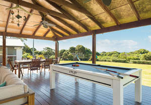 Amazing outdoor living space with pool table