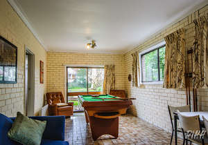 Second living area with pool table...