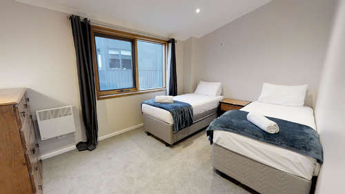 Upstairs room with ensuite and 2 single beds + 2 trundles