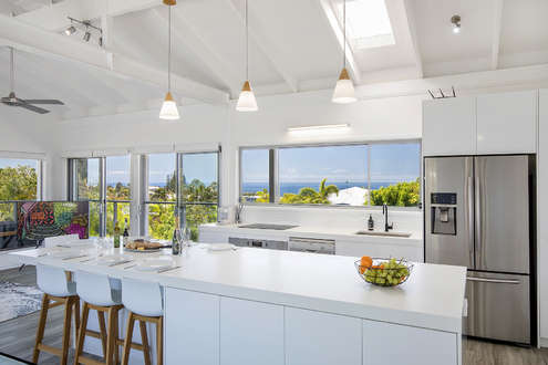 A Modern Designed Kitchen Creates A View From Dining