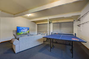 Third living area with TV and table tennis...