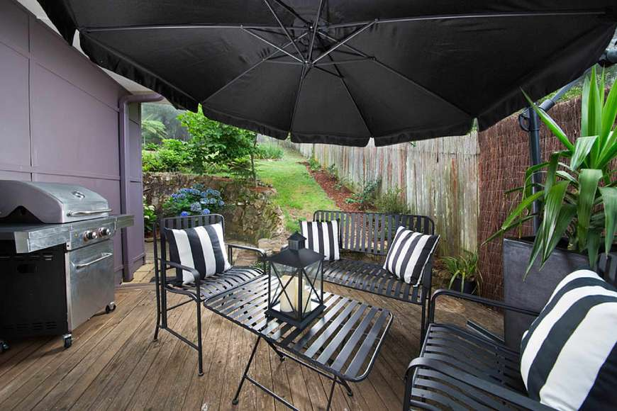 The umbrella provides shade for a lunchtime BBQ