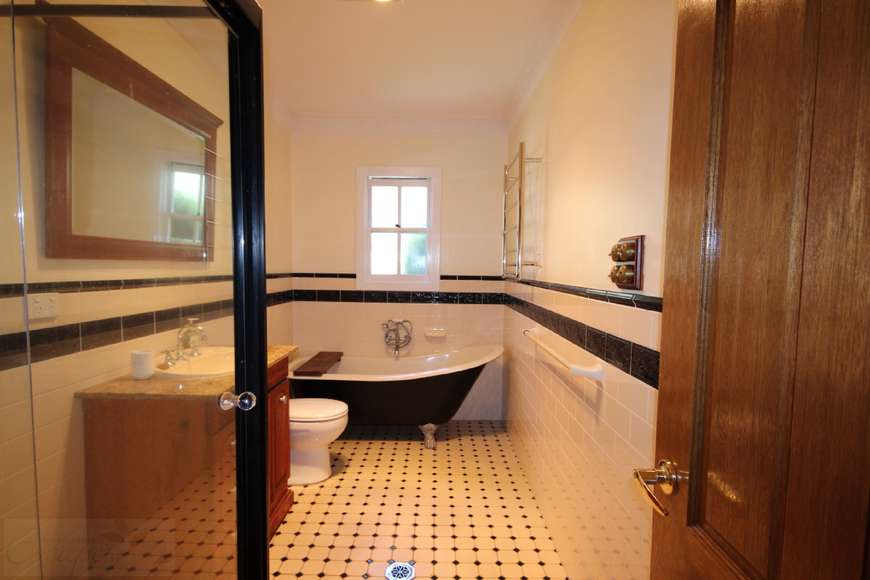 Main bathroom with separate shower and claw foot bath