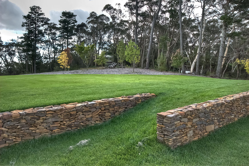 Rear lawn with stone wall