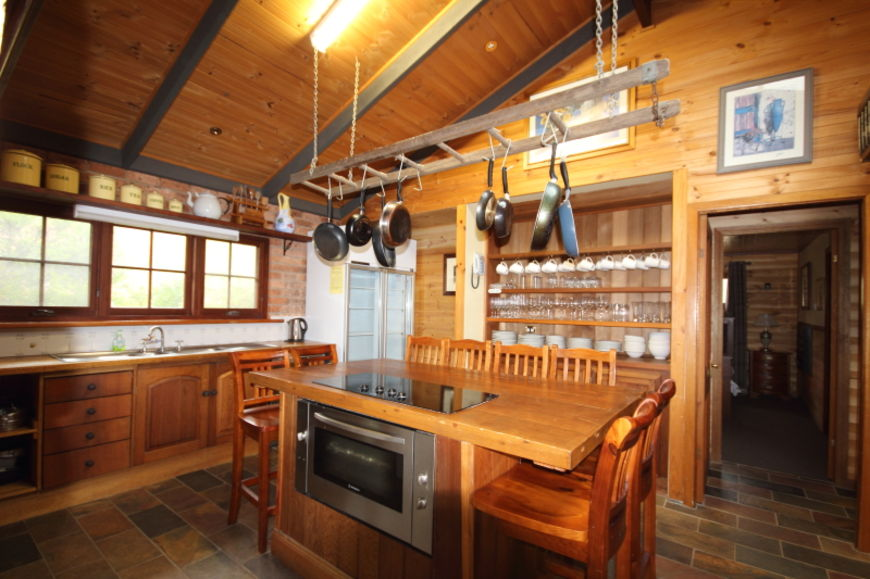 Large country kitchen with two cooktops and ovens