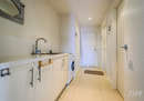 The main bathroom adjoins the laundry...