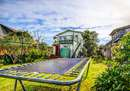 Huge, fully fenced backyard with trampoline...