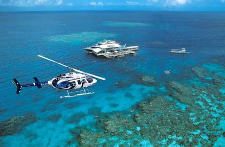 Fly out to the Outer Reef and cruise back